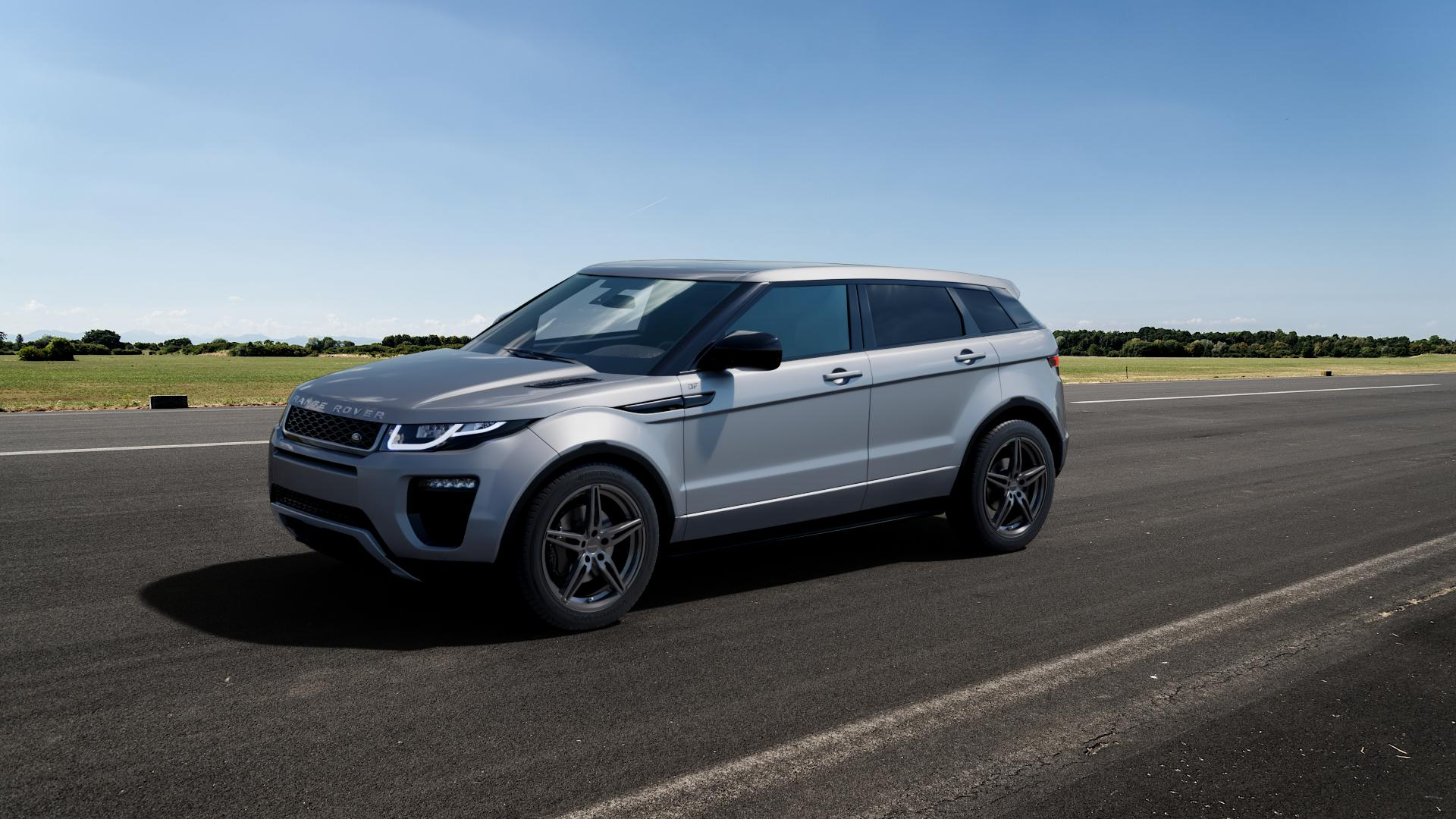 CARMANI 15 Oskar hyper gun Felge mit Reifen silber in 19Zoll Winterfelge Alufelge auf silbernem Land Rover Range Evoque Typ LV Facelift ⬇️ mit 15mm Tieferlegung ⬇️ Big_Vehicle_Airstrip_1 Frontansicht_1