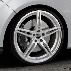 CARMANI 15 Oskar kristall silber Felge mit Reifen in 20Zoll Winterfelge Alufelge auf silbernem Ford Focus III Typ DYB (Schrägheck) (Stufenheck) Facelift ⬇️ mit 15mm Tieferlegung ⬇️ Industriehalle 1 Thumbnail
