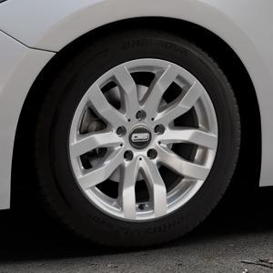 CMS C22 Racing Silver Felge mit Reifen silber in 16Zoll Winterfelge Alufelge auf silbernem Mazda 3 (13-) Stufenheck (BM) Sport (17-) Facelift Fließheck ⬇️ mit 15mm Tieferlegung ⬇️ Industriehalle 1 Thumbnail