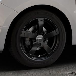DBV Torino II schwarz matt Felge mit Reifen in 15Zoll Winterfelge Alufelge auf silbernem Dacia Logan II Typ SD ⬇️ mit 15mm Tieferlegung ⬇️ Industriehalle 1 Thumbnail