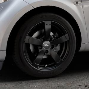 DBV Torino II schwarz matt Felge mit Reifen in 15Zoll Winterfelge Alufelge auf silbernem Smart Fortwo Coupe III (14-) (453) Cabrio (16-) ⬇️ mit 15mm Tieferlegung ⬇️ Industriehalle 1 Thumbnail
