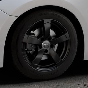 DBV Torino II schwarz matt Felge mit Reifen in 16Zoll Winterfelge Alufelge auf silbernem Mazda 3 (13-) Stufenheck (BM) Sport (17-) Facelift Fließheck ⬇️ mit 15mm Tieferlegung ⬇️ Industriehalle 1 Thumbnail