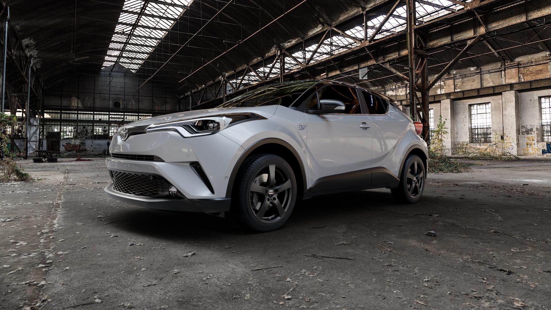 DEZENT RE BLACK MATT Felge mit Reifen schwarz in 18Zoll Winterfelge Alufelge auf silbernem Toyota C-HR Typ AX1T(EU,M) AX1T(EU,M)-TMG ⬇️ mit 15mm Tieferlegung ⬇️ Industriehalle 1 Camera_000