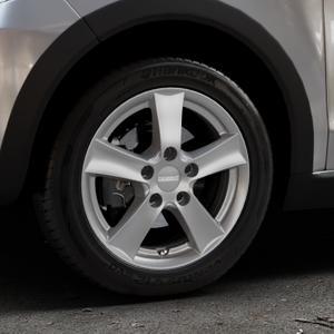 DEZENT TX GRAPHITE MATT Felge mit Reifen grau in 15Zoll Winterfelge Alufelge auf silbernem Volkswagen (VW) UP Cross ⬇️ mit 15mm Tieferlegung ⬇️ Industriehalle 1 Thumbnail