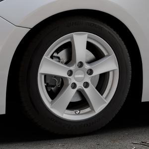 DEZENT TX Graphite matt Felge mit Reifen grau in 16Zoll Winterfelge Alufelge auf silbernem Mazda 3 (13-) Stufenheck (BM) Sport (17-) Facelift Fließheck ⬇️ mit 15mm Tieferlegung ⬇️ Industriehalle 1 Thumbnail