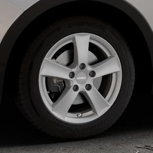 DEZENT TX Graphite matt Felge mit Reifen grau in 16Zoll Winterfelge Alufelge auf silbernem Ssangyong Tivoli Typ XK ⬇️ mit 15mm Tieferlegung ⬇️ Industriehalle 1 Thumbnail