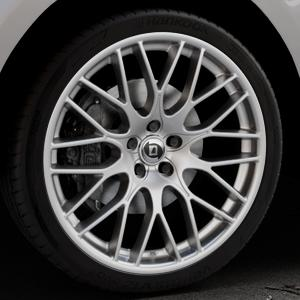 DIEWE WHEELS Impatto Argento silber Felge mit Reifen in 22Zoll Winterfelge Alufelge auf silbernem Jaguar F-Pace Typ DC ⬇️ mit 15mm Tieferlegung ⬇️ Industriehalle 1 Thumbnail
