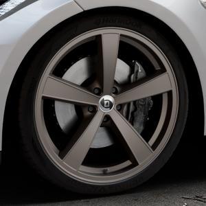 DIEWE WHEELS Trina Bruno Felge mit Reifen braun in 21Zoll Winterfelge Alufelge auf silbernem Tesla Model S Typ 002 ⬇️ mit 15mm Tieferlegung ⬇️ Industriehalle 1 Thumbnail