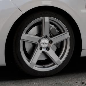 DOTZ CP5 Graphite matt Felge mit Reifen grau in 17Zoll Winterfelge Alufelge auf silbernem Peugeot 208 Typ C ⬇️ mit 15mm Tieferlegung ⬇️ Industriehalle 1 Thumbnail