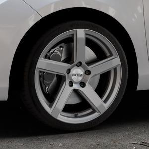 DOTZ CP5 Graphite matt Felge mit Reifen grau in 17Zoll Winterfelge Alufelge auf silbernem Toyota Yaris III Typ XP13 Facelift 17-> ⬇️ mit 15mm Tieferlegung ⬇️ Industriehalle 1 Thumbnail
