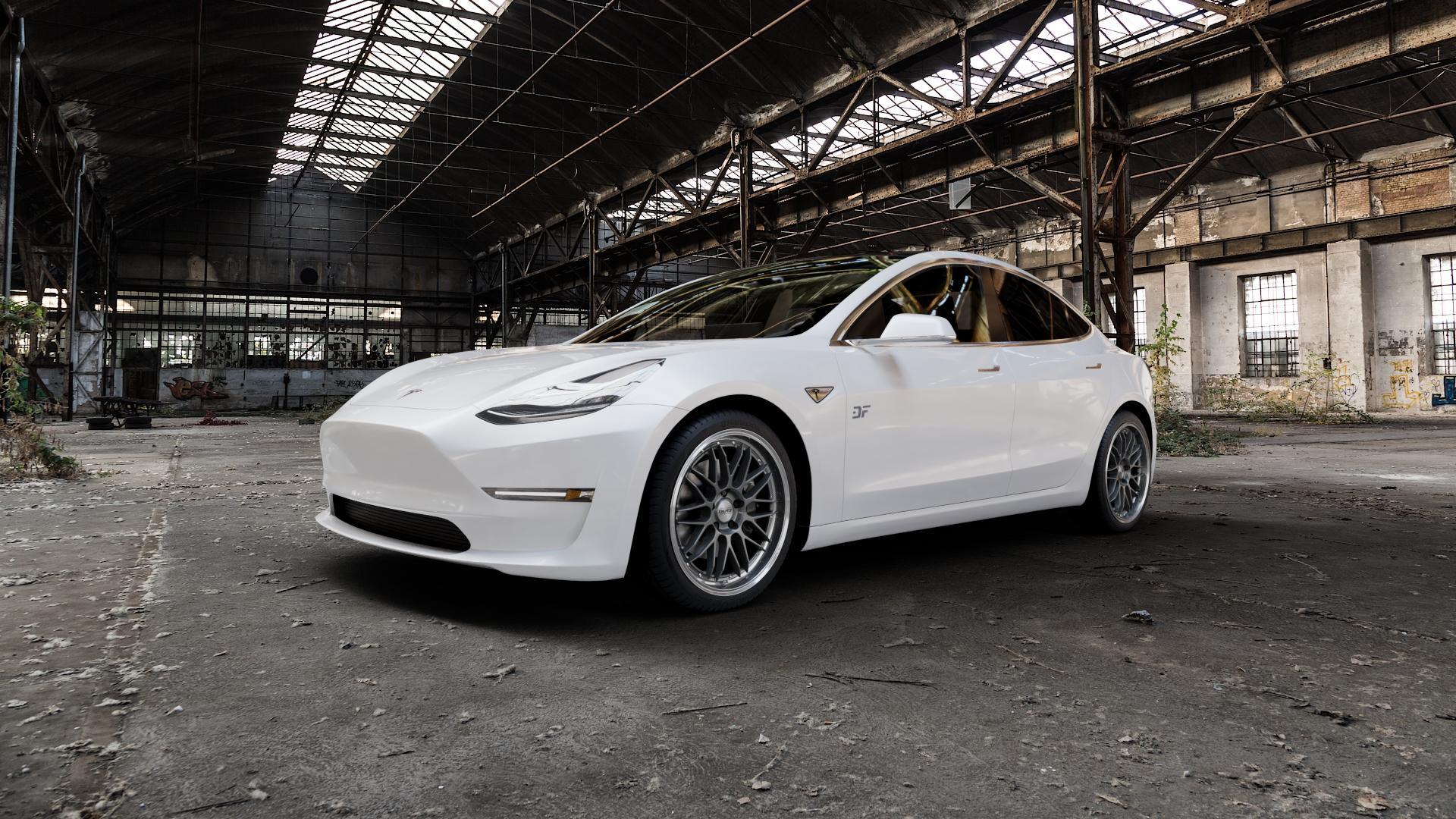 DOTZ REVVO GUNMETAL POLISHED Felge mit Reifen grau silber mehrfarbig in 19Zoll Alufelge auf weissem Tesla Model 3 Typ 003 ⬇️ mit 15mm Tieferlegung ⬇️ Industriehalle 1 Camera_000