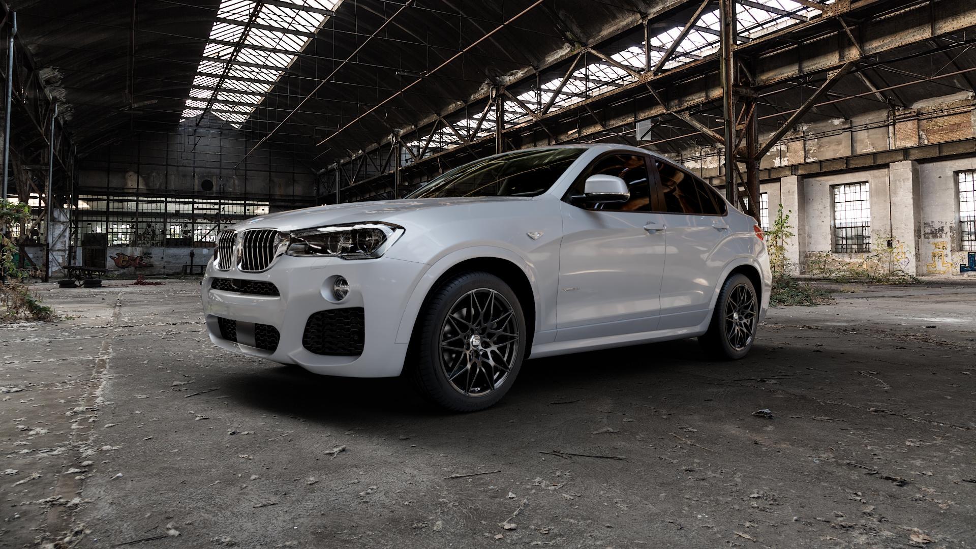 MAM B2 BLACK PAINTED Felge mit Reifen schwarz in 19Zoll Winterfelge Alufelge auf silbernem BMW X4 Typ F26 (X3, X-N1) ⬇️ mit 15mm Tieferlegung ⬇️ Industriehalle 1 Camera_000
