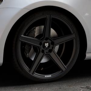 MB-DESIGN KV1 Mattschwarz Felge mit Reifen in 19Zoll Winterfelge Alufelge auf silbernem Volkswagen (VW) Golf 7 ⬇️ mit 15mm Tieferlegung ⬇️ Industriehalle 1 Thumbnail