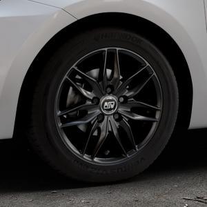 MSW 24 MATT BLACK Felge mit Reifen schwarz in 15Zoll Winterfelge Alufelge auf silbernem Suzuki Swift VI Typ AZ ⬇️ mit 15mm Tieferlegung ⬇️ Industriehalle 1 Thumbnail