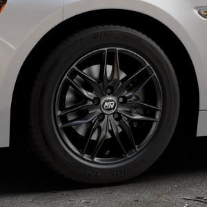 MSW 24 MATT BLACK Felge mit Reifen schwarz in 16Zoll Winterfelge Alufelge auf silbernem Fiat 124 Spider Typ NF ⬇️ mit 15mm Tieferlegung ⬇️ Industriehalle 1 Thumbnail