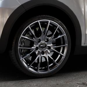 MSW 25 MATT TITANIUM TECH Felge mit Reifen in 17Zoll Winterfelge Alufelge auf silbernem Volkswagen (VW) UP Cross ⬇️ mit 15mm Tieferlegung ⬇️ Industriehalle 1 Thumbnail