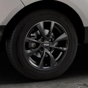 OXXO Oberon 4 Black Felge mit Reifen schwarz in 15Zoll Winterfelge Alufelge auf silbernem Ford EcoSport Typ JK8 Facelift ⬇️ mit 15mm Tieferlegung ⬇️ Industriehalle 1 Thumbnail