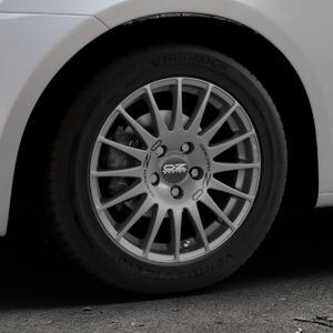 OZ RACING SUPERTURISMO GT GRIGIO CORSA Felge mit Reifen silber in 15Zoll Winterfelge Alufelge auf silbernem Suzuki Swift V Typ NZ FZ ⬇️ mit 15mm Tieferlegung ⬇️ Industriehalle 1 Thumbnail