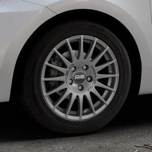 OZ RACING SUPERTURISMO GT GRIGIO CORSA Felge mit Reifen silber in 15Zoll Winterfelge Alufelge auf silbernem Suzuki Swift VI Typ AZ ⬇️ mit 15mm Tieferlegung ⬇️ Industriehalle 1 Thumbnail