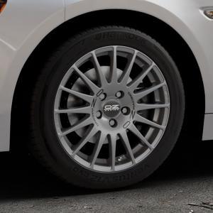 OZ RACING SUPERTURISMO GT GRIGIO CORSA Felge mit Reifen silber in 16Zoll Winterfelge Alufelge auf silbernem Fiat 124 Spider Typ NF ⬇️ mit 15mm Tieferlegung ⬇️ Industriehalle 1 Thumbnail