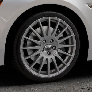 OZ RACING SUPERTURISMO GT GRIGIO CORSA Felge mit Reifen silber in 18Zoll Winterfelge Alufelge auf silbernem Fiat 124 Spider Typ NF ⬇️ mit 15mm Tieferlegung ⬇️ Industriehalle 1 Thumbnail