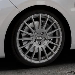 OZ RACING SUPERTURISMO GT GRIGIO CORSA Felge mit Reifen silber in 18Zoll Winterfelge Alufelge auf silbernem Peugeot 208 Typ C ⬇️ mit 15mm Tieferlegung ⬇️ Industriehalle 1 Thumbnail