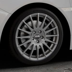 OZ RACING SUPERTURISMO GT GRIGIO CORSA Felge mit Reifen silber in 18Zoll Winterfelge Alufelge auf silbernem Subaru WRX Typ V1 2,5l STI AWD 221kW (300 PS) ⬇️ mit 15mm Tieferlegung ⬇️ Industriehalle 1 Thumbnail