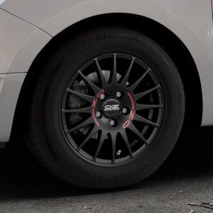 OZ RACING SUPERTURISMO GT MATT BLACK Felge mit Reifen schwarz in 14Zoll Winterfelge Alufelge auf silbernem Dacia Logan II Typ SD ⬇️ mit 15mm Tieferlegung ⬇️ Industriehalle 1 Thumbnail