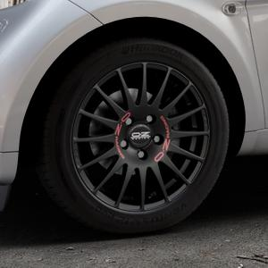 OZ RACING SUPERTURISMO GT MATT BLACK Felge mit Reifen schwarz in 15Zoll Winterfelge Alufelge auf silbernem Smart Fortwo Coupe III (14-) (453) Cabrio (16-) ⬇️ mit 15mm Tieferlegung ⬇️ Industriehalle 1 Thumbnail