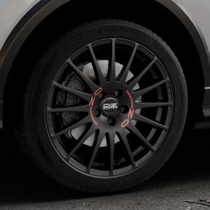 OZ RACING SUPERTURISMO GT MATT BLACK Felge mit Reifen schwarz in 18Zoll Winterfelge Alufelge auf silbernem Audi Q2 Typ GA ⬇️ mit 15mm Tieferlegung ⬇️ Industriehalle 1 Thumbnail