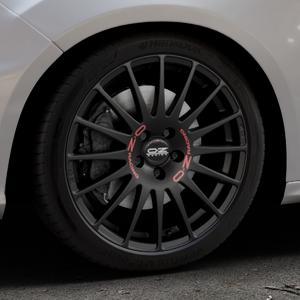OZ RACING SUPERTURISMO GT MATT BLACK Felge mit Reifen schwarz in 18Zoll Winterfelge Alufelge auf silbernem Ford Focus III Typ DYB Facelift (Schrägheck) 2,3l EcoBoost 257kW RS (349 PS) ⬇️ mit 15mm Tieferlegung ⬇️ Industriehalle 1 Thumbnail