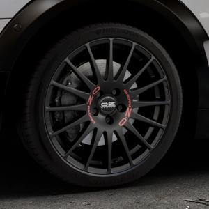 OZ RACING SUPERTURISMO GT MATT BLACK Felge mit Reifen schwarz in 18Zoll Winterfelge Alufelge auf silbernem Mini F54 Typ UKL-L (Clubman) FMK ⬇️ mit 15mm Tieferlegung ⬇️ Industriehalle 1 Thumbnail