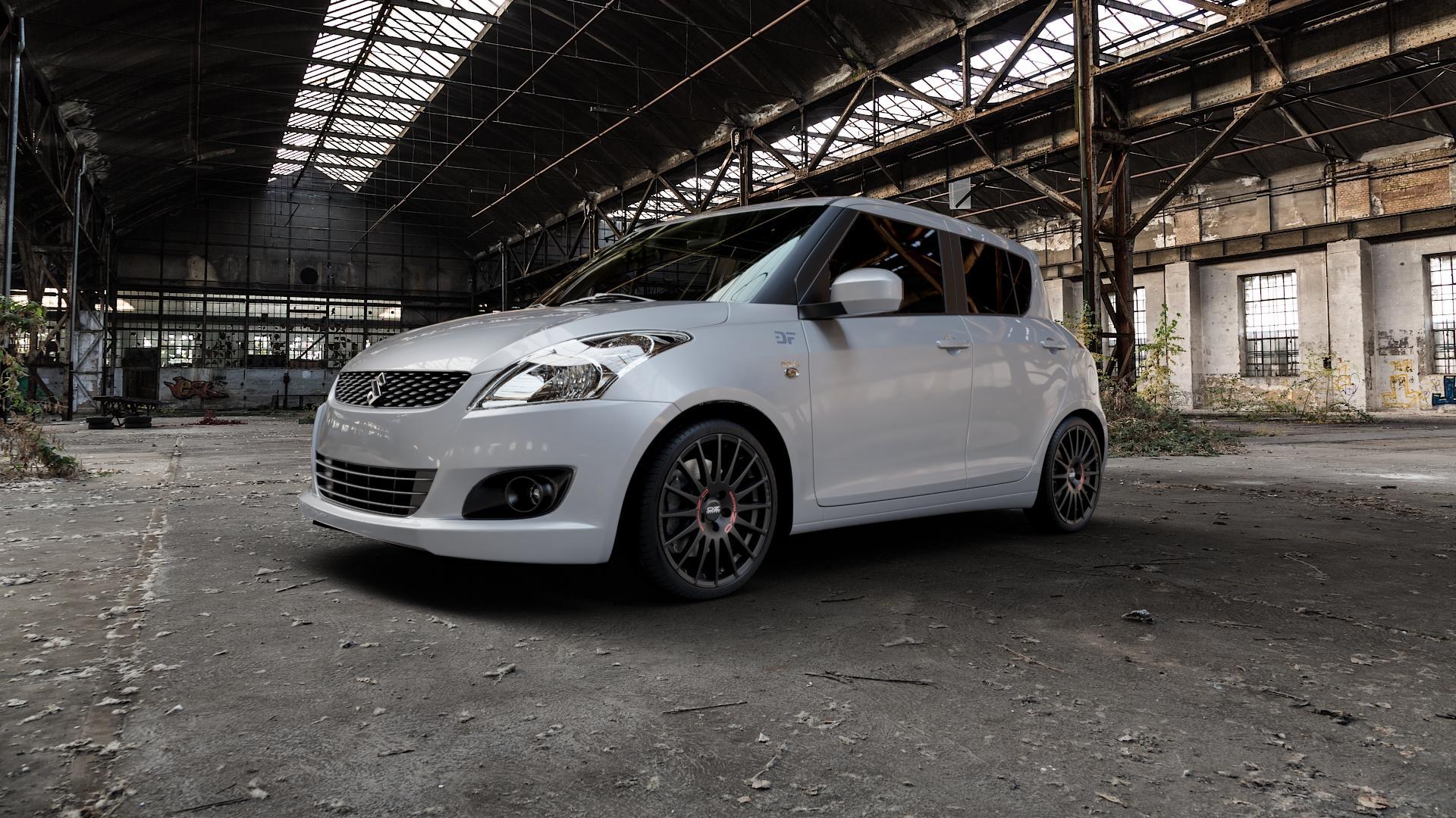 OZ RACING SUPERTURISMO GT MATT BLACK Felge mit Reifen schwarz in 18Zoll Winterfelge Alufelge auf silbernem Suzuki Swift V Typ NZ FZ ⬇️ mit 15mm Tieferlegung ⬇️ Industriehalle 1 Camera_000