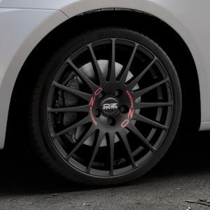 OZ RACING SUPERTURISMO GT MATT BLACK Felge mit Reifen schwarz in 18Zoll Winterfelge Alufelge auf silbernem Suzuki Swift V Typ NZ FZ ⬇️ mit 15mm Tieferlegung ⬇️ Industriehalle 1 Thumbnail