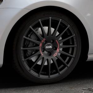 OZ RACING SUPERTURISMO GT MATT BLACK Felge mit Reifen schwarz in 18Zoll Winterfelge Alufelge auf silbernem Volkswagen (VW) Golf 7 ⬇️ mit 15mm Tieferlegung ⬇️ Industriehalle 1 Thumbnail