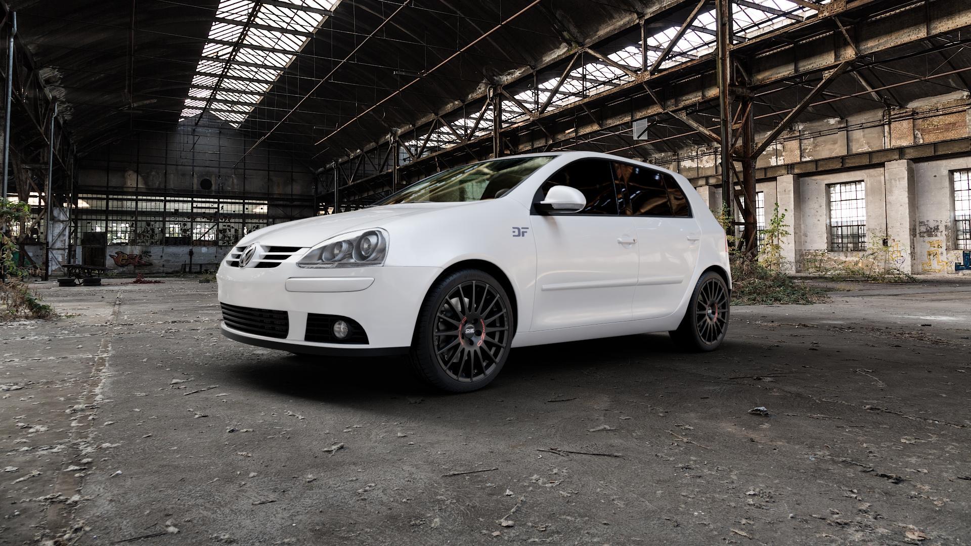 OZ RACING SUPERTURISMO GT MATT BLACK Felge mit Reifen schwarz in 18Zoll Winterfelge Alufelge auf weissem Volkswagen (VW) Golf 5 Plus ⬇️ mit 15mm Tieferlegung ⬇️ Industriehalle 1 Camera_000