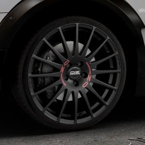 OZ RACING SUPERTURISMO GT MATT BLACK Felge mit Reifen schwarz in 19Zoll Winterfelge Alufelge auf silbernem Mini F54 Typ UKL-L (Clubman) FMK ⬇️ mit 15mm Tieferlegung ⬇️ Industriehalle 1 Thumbnail