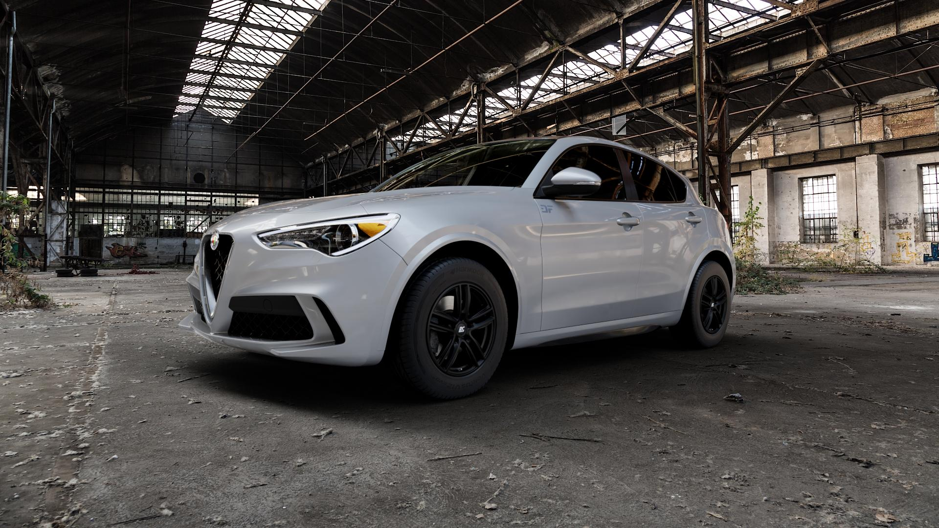 RC Design RC27 schwarz-matt lackiert Felge mit Reifen in 17Zoll Winterfelge Alufelge auf silbernem Alfa Romeo Stelvio Typ 949 ⬇️ mit 15mm Tieferlegung ⬇️ Industriehalle 1 Camera_000
