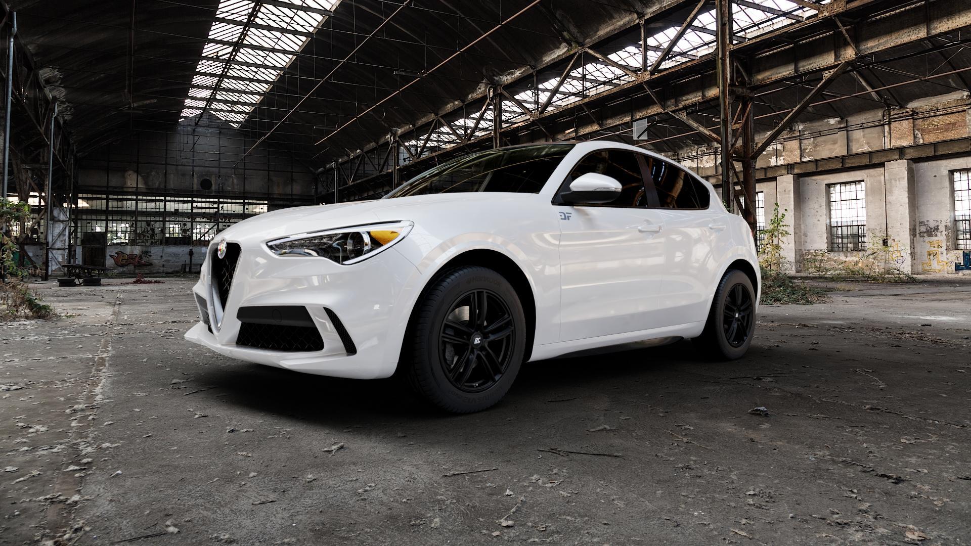 RC Design RC27 schwarz-matt lackiert Felge mit Reifen in 18Zoll Winterfelge Alufelge auf weissem Alfa Romeo Stelvio Typ 949 ⬇️ mit 15mm Tieferlegung ⬇️ Industriehalle 1 Camera_000