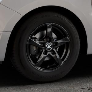 RC Design RC30 schwarz lackiert Felge mit Reifen in 14Zoll Winterfelge Alufelge auf silbernem Dacia Logan II Typ SD ⬇️ mit 15mm Tieferlegung ⬇️ Industriehalle 1 Thumbnail