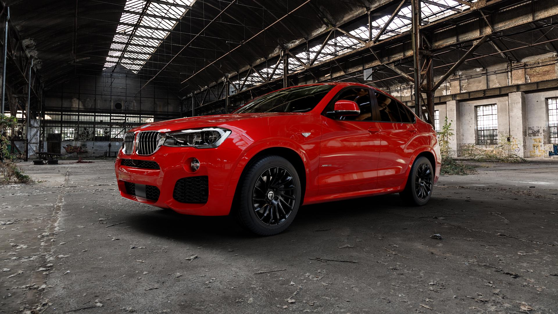 TOMASON TN16 Black painted Felge mit Reifen schwarz in 18Zoll Winterfelge Alufelge auf rotem BMW X4 Typ F26 (X3, X-N1) ⬇️ mit 15mm Tieferlegung ⬇️ Industriehalle 1 Camera_000