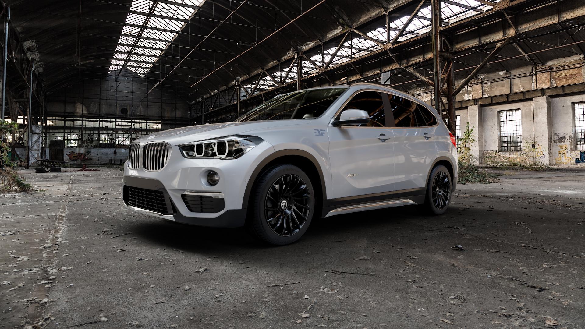 TOMASON TN16 Black painted Felge mit Reifen schwarz in 18Zoll Winterfelge Alufelge auf silbernem BMW X1 Typ F48 (UKL-L) (F1X) ⬇️ mit 15mm Tieferlegung ⬇️ Industriehalle 1 Camera_000