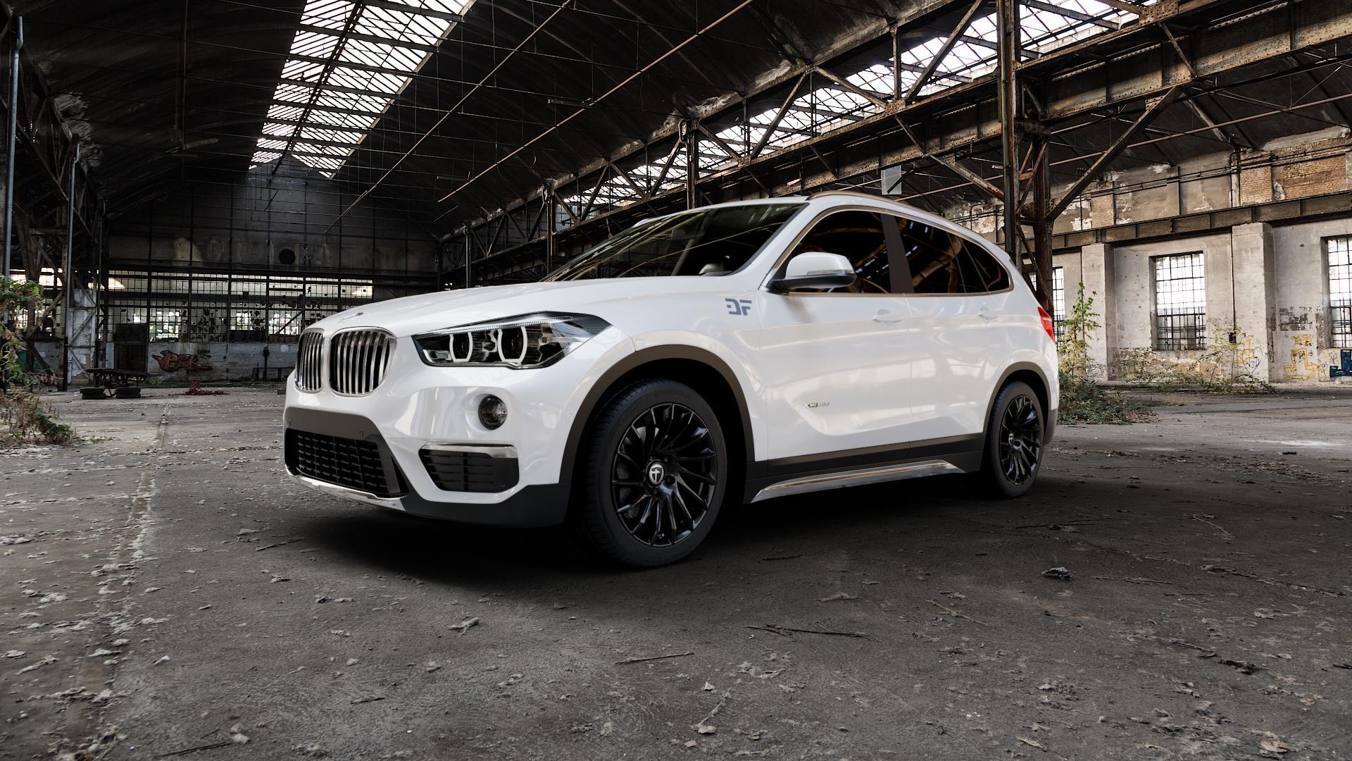 TOMASON TN16 Black painted Felge mit Reifen schwarz in 18Zoll Winterfelge Alufelge auf weissem BMW X1 Typ F48 (UKL-L) (F1X) ⬇️ mit 15mm Tieferlegung ⬇️ Industriehalle 1 Camera_000