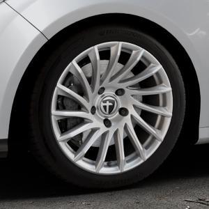 TOMASON TN16 Bright Silver Felge mit Reifen silber in 17Zoll Winterfelge Alufelge auf silbernem Ford Focus III Typ DYB (Schrägheck) (Stufenheck) Facelift ⬇️ mit 15mm Tieferlegung ⬇️ Industriehalle 1 Thumbnail