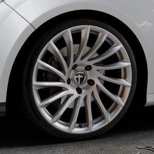 TOMASON TN16 Bright Silver Felge mit Reifen silber in 19Zoll Winterfelge Alufelge auf silbernem Ford Focus III Typ DYB (Schrägheck) (Stufenheck) Facelift ⬇️ mit 15mm Tieferlegung ⬇️ Industriehalle 1 Thumbnail